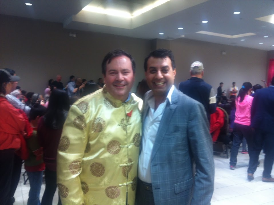 Aditya Tawatia with Defense Minister Jason Kenney during an event in Surrey BC